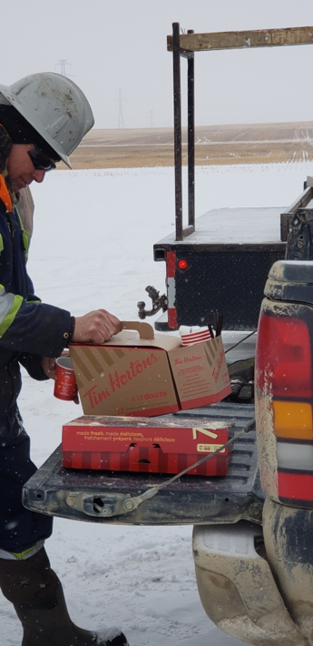 Figure 1: Can't get more Canadian than serving Tim Horton's coffee to keep everyone warm during the tail gate safety meeting in the morning as Pulse and its experienced operators are always considering Health, Safety & Environment.